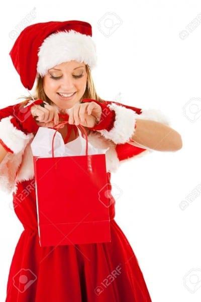 Caucasian Female Dressed In A Cute Santa Elf Outfit  Stock Photo
