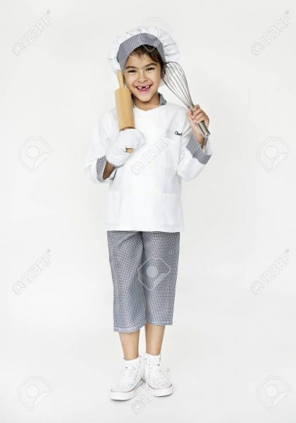 Girl With Chef Costume For Dream Job Stock Photo, Picture And
