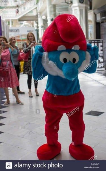 Wearing Papa Smurf Costume Women Stock Photos & Wearing Papa Smurf