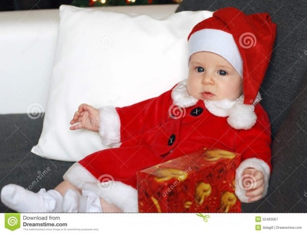 Little Baby Girl Wearing A Cute Santa Claus Costume Stock Image
