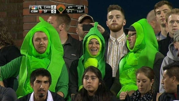 Three Fans Enjoy The Game In Pea Pod Costumes