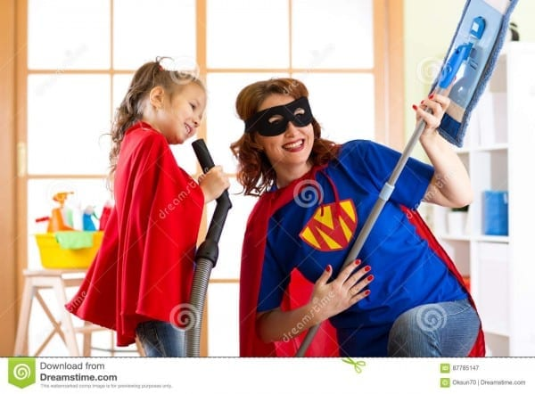Preschooler Girl And Her Mother Dressed Like Superheroes  Middle