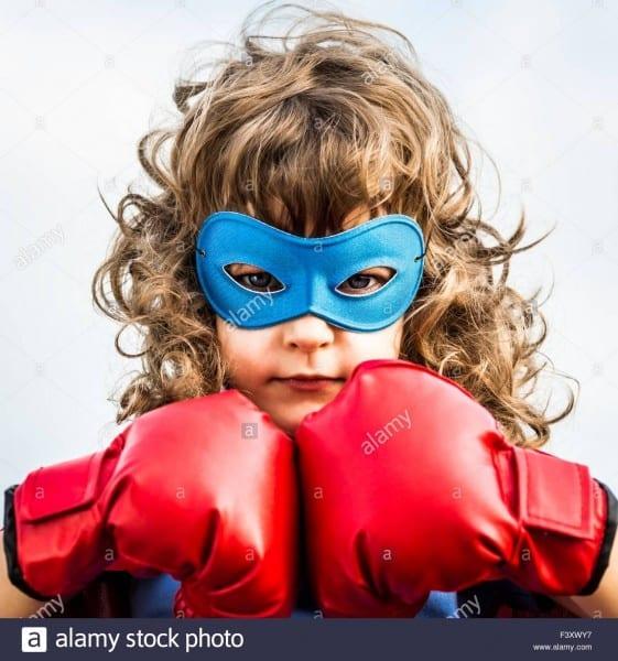 Superhero Kid Girl Boxing Gloves Stock Photos & Superhero Kid Girl