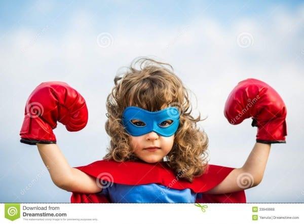 Superhero Kid  Girl Power Concept Stock Photo