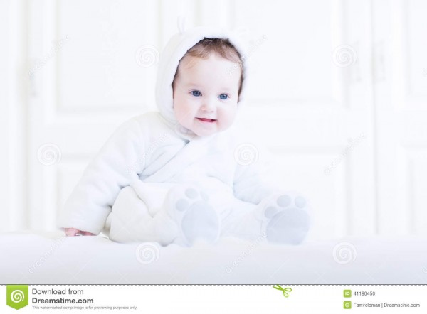Funny Baby Wearing A Teddy Bear Snow Suit Stock Photo