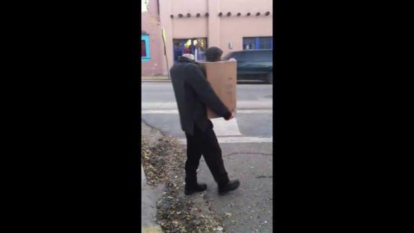 Headless Man Carrying Box
