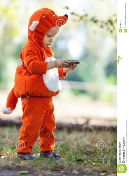Toddler Boy In Fox Costume Holding Smartphone Stock Image