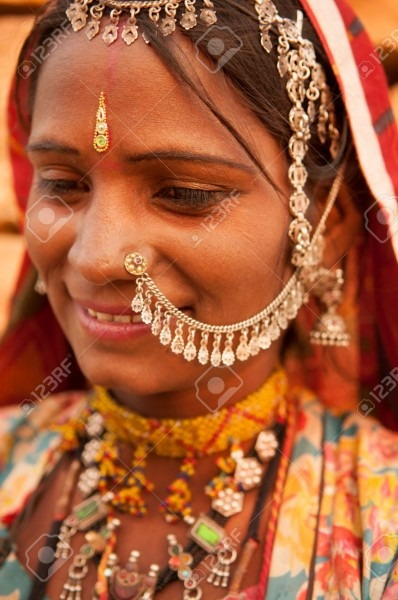 Portrait Of Beautiful Traditional Indian Woman In Sari Costume
