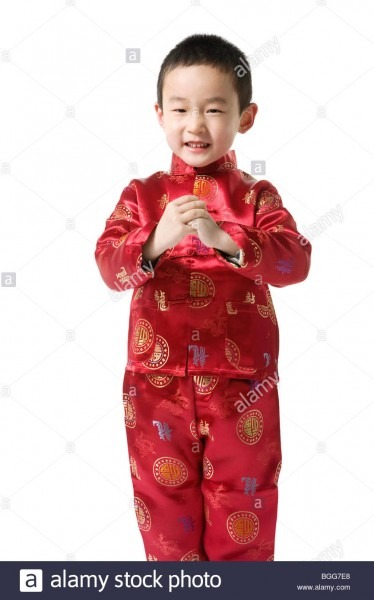 Boy In Chinese Traditional Clothes Doing Chinese New Year Greeting