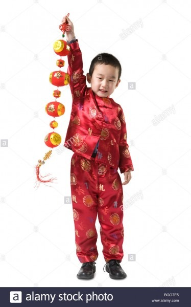 Boy In Chinese Traditional Clothes Holding Chinese New Year Stock