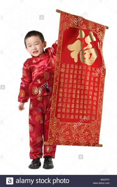 Boy In Chinese Traditional Clothes Holding Chinese New Year Scroll