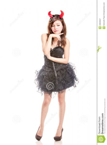 Chinese Woman In Black Dress And Devil Horns Stock Image