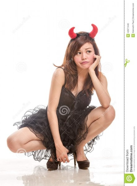Chinese Woman In Black Dress And Devil Horns Squatting Down Look