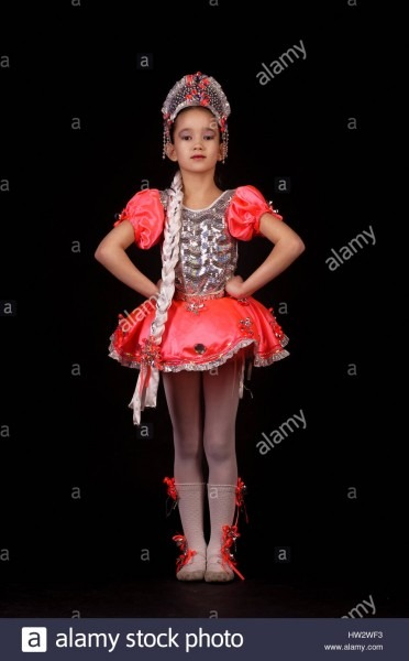 Cute Little Girl Wearing Native Russian Costume Isolated On Black