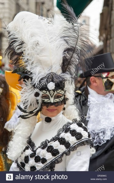 Lady In Black & White Costume And Columbina Mask During The Venice
