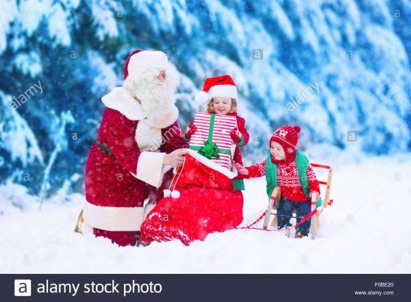 Santa Claus And Children Opening Presents In Snowy Forest  Kids