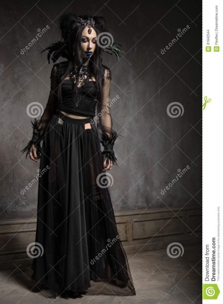 Young Woman In Black Fantasy Costume Stock Photo