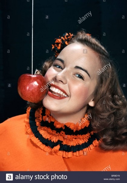 1940s 1950s Smiling Young Woman Wearing Halloween Costume Bobbing