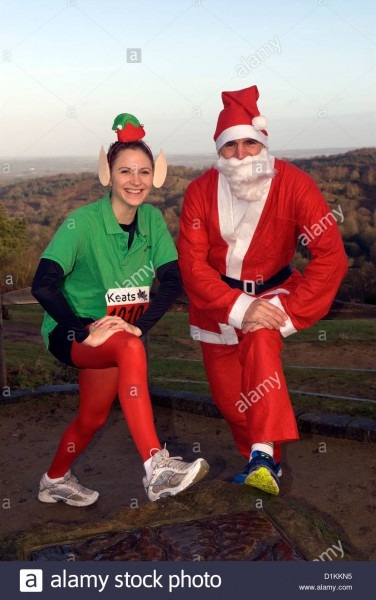 25 Year Old Woman And 54 Year Old Man In Christmas Fancy Dress