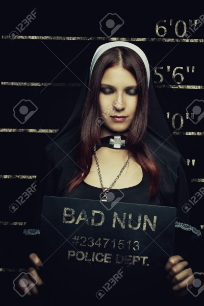 Mugshot Of Seductive Girl In Nun Costume Stock Photo, Picture And