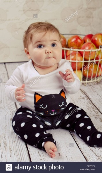 6 Month Old Baby Girl In Her Halloween Outfit Sitting Next To A