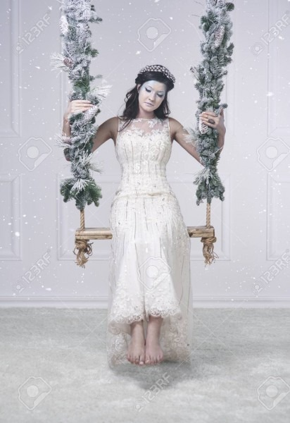 Woman In Snow Queen Costume On Swing Stock Photo, Picture And