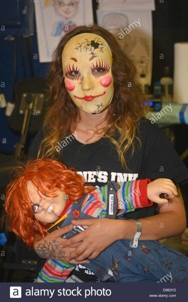 Girl In A Mask With A Chucky Doll At The New York Tattoo Festival