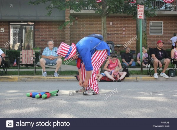 Juggler Dressed Up In A Red White And Blue Uncle Sam Outfit And