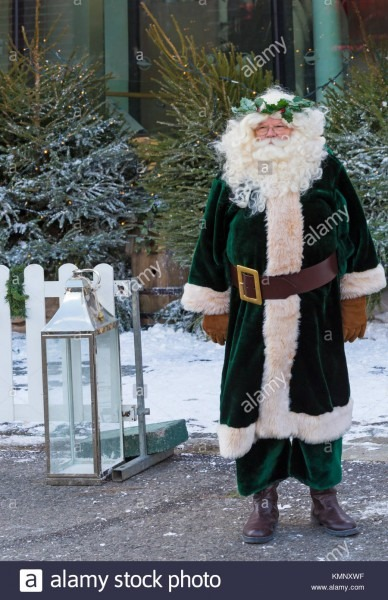 Santa Claus Dressed In Green Victorian Father Christmas Costume At