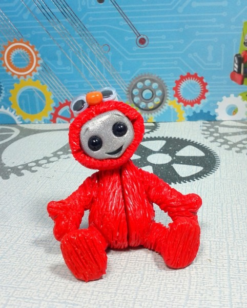Robot In A Tickle Me Elmo Costume