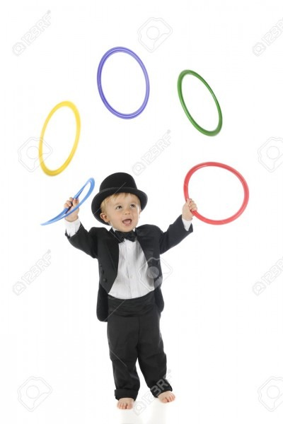 An Adorable, Barefoot Toddler Juggling Colorful Rings In His