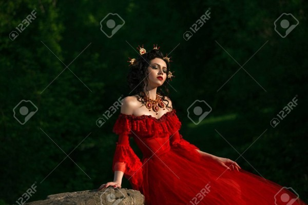 Countess In A Long Red Dress Is Walking In A Green Forest Full