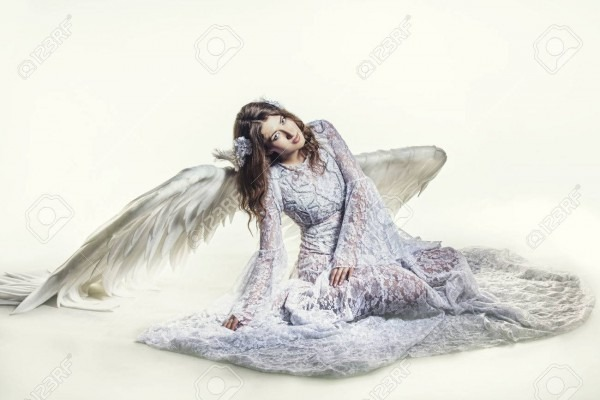Woman Angel With White Wings Costume In A Religious Sense Stock