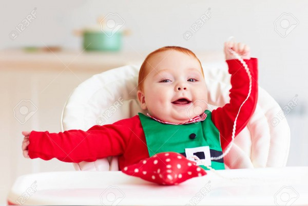 Cute Infant Redhead Baby Boy In Elf Costume Playing With Red