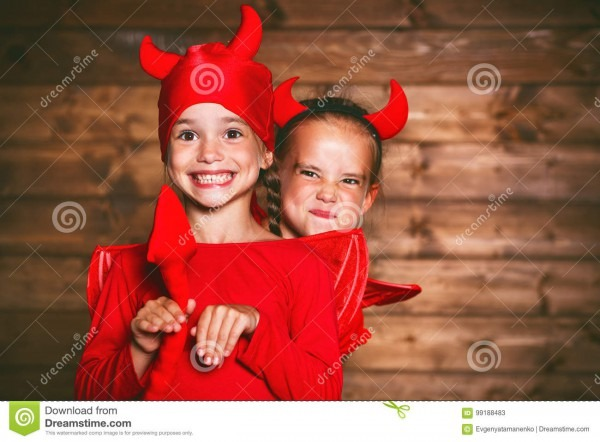 Holiday Halloween  Funny Funny Sisters Twins Children In Carnival