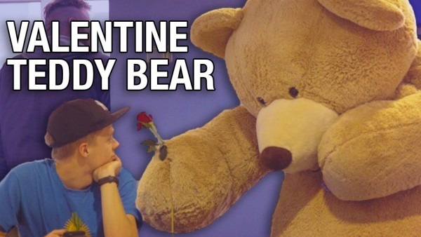 Giant Teddy Bear Hands Out Flowers