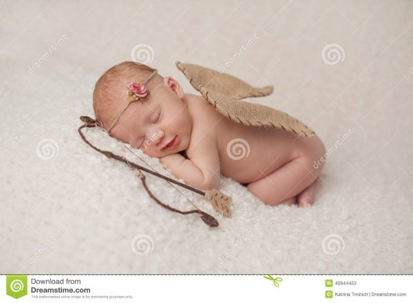 Newborn Baby Girl With Cupid Wings And Archery Set Stock Image