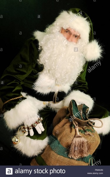 Santa Claus In Green Suit Holding Presents  Green Santa Holding