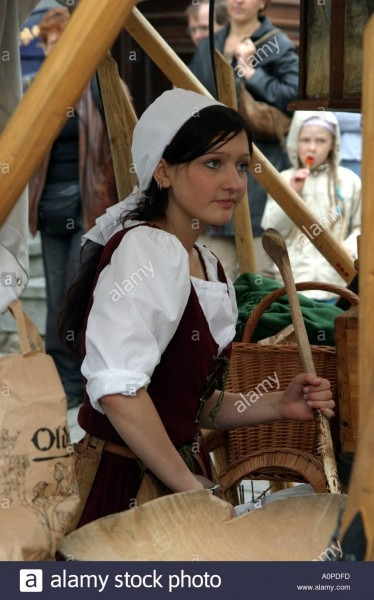 Stallholder Wearing Traditional Costume In The Town Hall Square