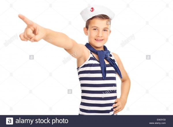 Studio Shot Of A Little Male Kid In A Sailor Costume Pointing