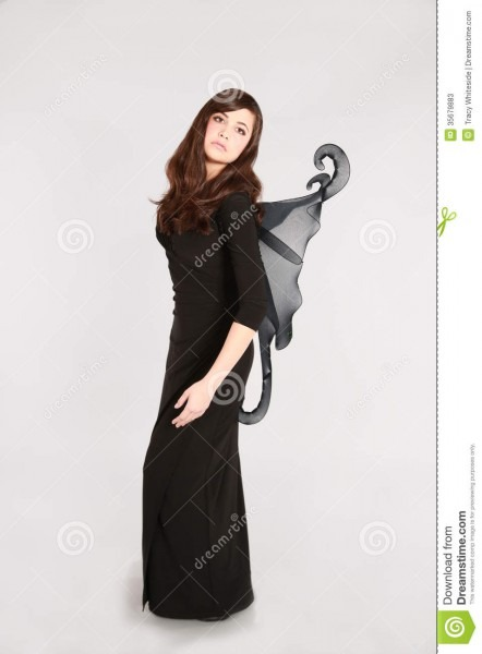 Teen Girl In Dark Fairy Costume Stock Image