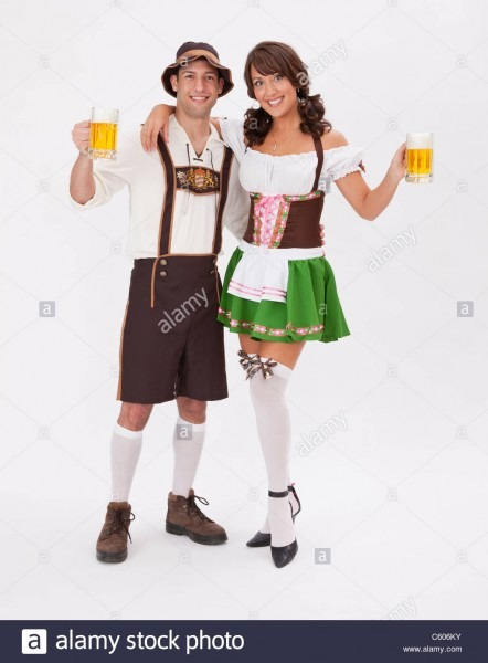 Young Couple Wearing Oktoberfest Costume Holding Beer Stein