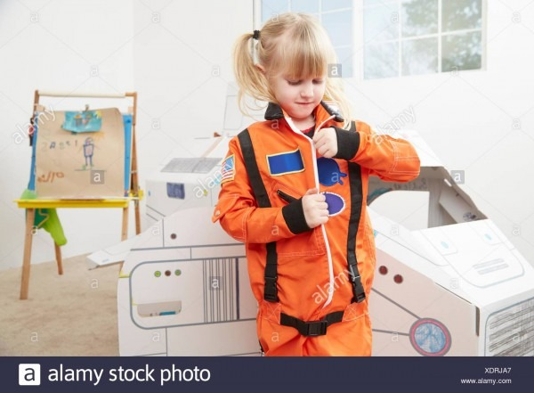 Young Girl Playing Dress Up, Wearing Astronaut Outfit Stock Photo