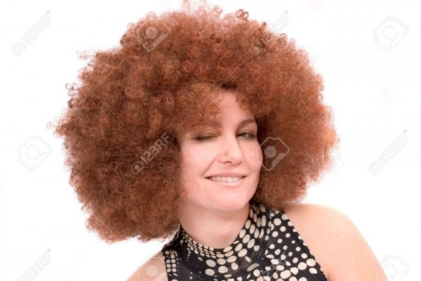 Pretty Woman With Red Afro Wig Winking Stock Photo, Picture And