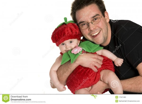 Father Holding Baby Wearing Halloween Costume Stock Photo