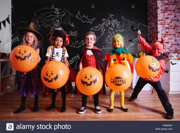 Portrait Of Children In Costumes On Halloween Party Stock Photo