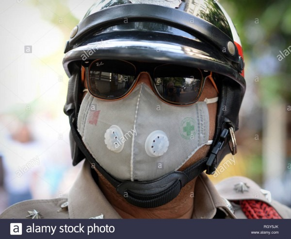 Royal Thai Motorcycle Police Officer Wears Mirrored Sunglasses And