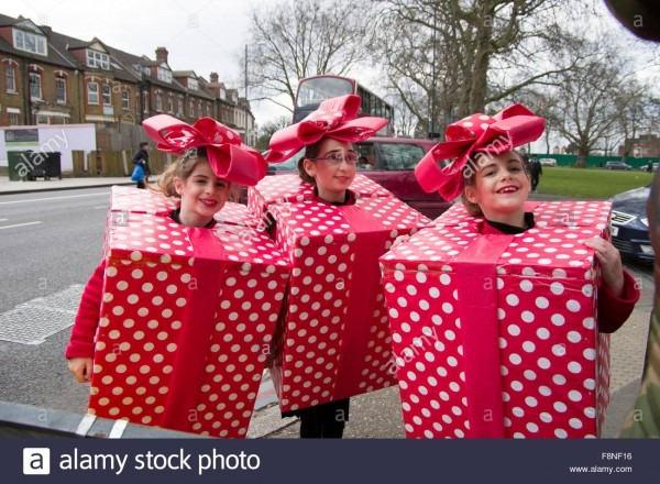 Three Cheerful Girls In Homemade Fancy Dress Costumes For The