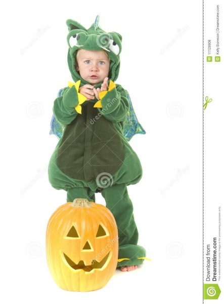 Trick Or Treating Toddler Wearing Dragon Costume Stock Photo