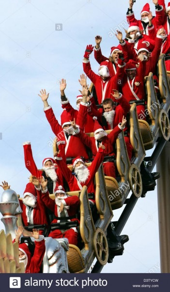 Visitors Dressed As Santa Claus Ride The Rollercoaster At The